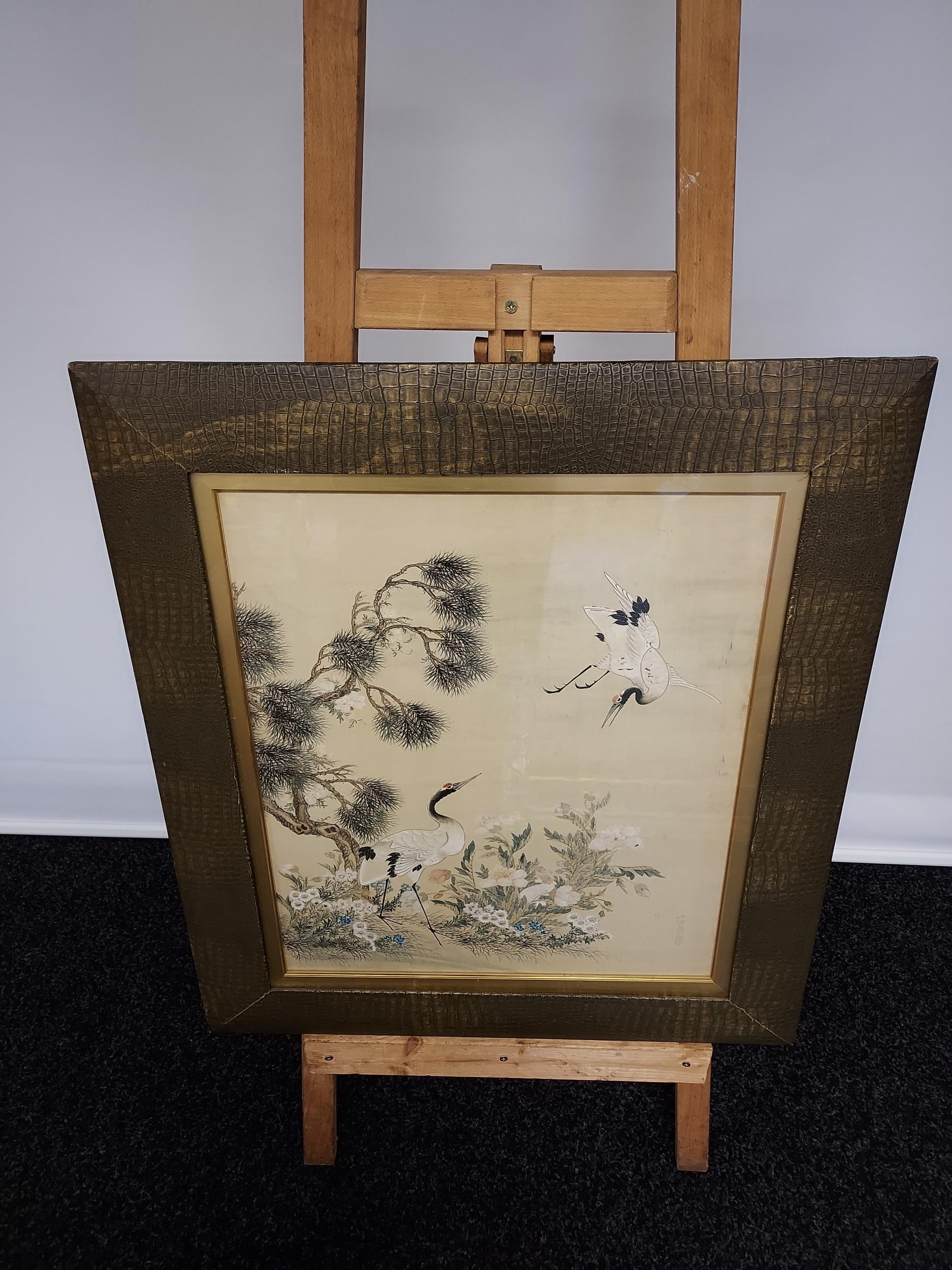 A Large 18th/ 19th century Chinese/ Japanese silk painting depicting cranes surrounded by tree and