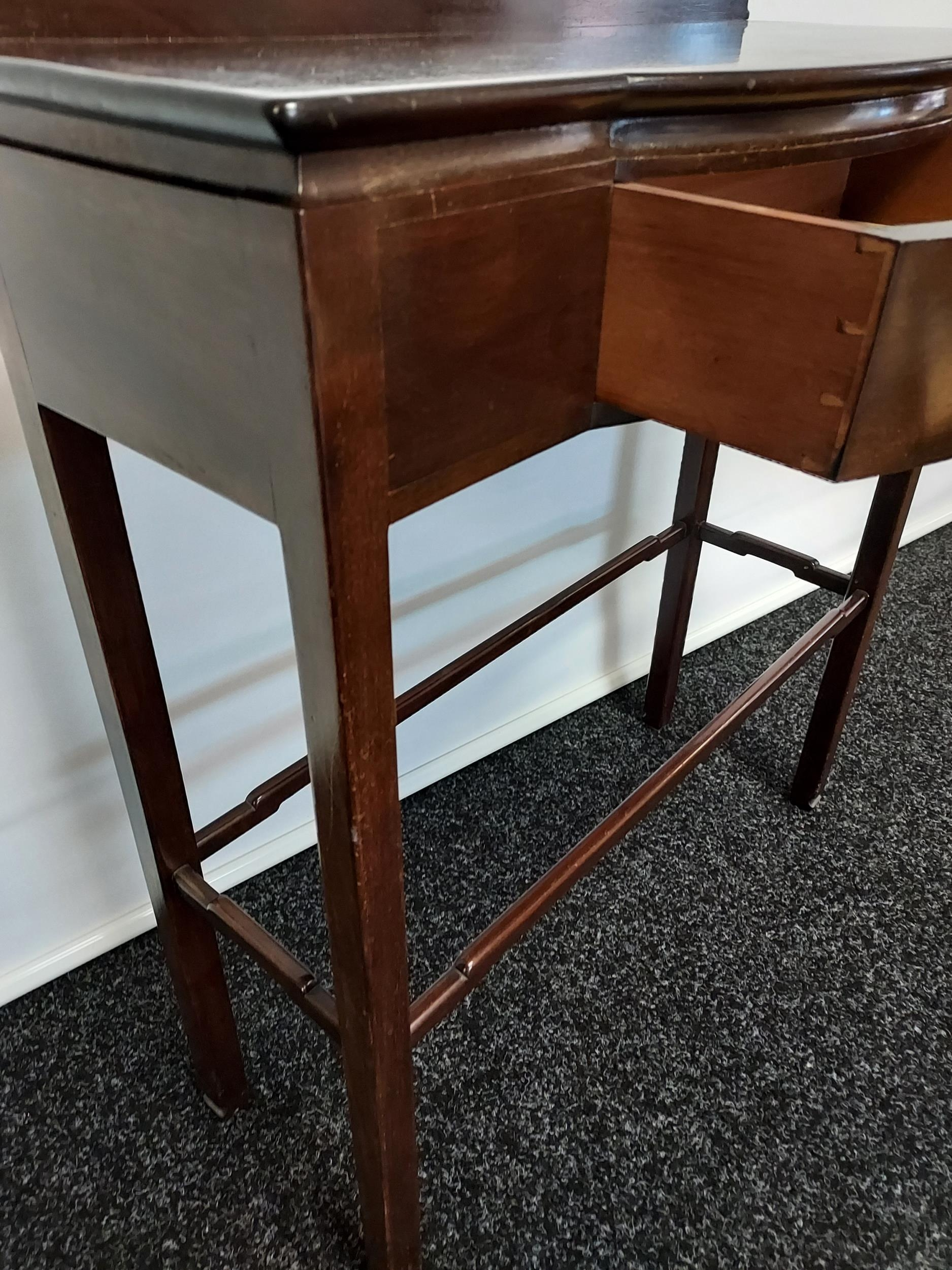 A dark wood console table, with bow front single drawer, raised on square legs, united with - Image 3 of 4
