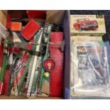 A Box containing a selection of various Meccano parts, magazines and instructions.