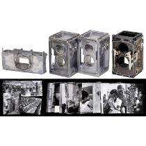 3 Kamera-Gußteile und 30 Rollei-Werksphotos1-2) Zwei identische Rohkörper einer TLR-Rollei, ohne