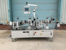 Pago model System 565 wrap labeller designed for precision labelling