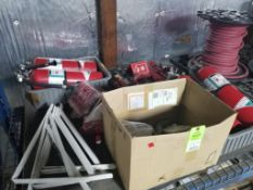 Pallet of assorted fire safety equipment.