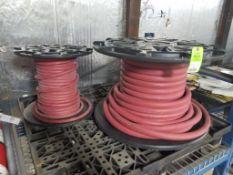 Qty 2 - Rolls of hose.