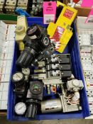 Large assortment of pneumatic valves and regulators.