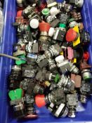 Large assortment of switches, buttons, and pilot lights.