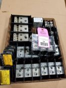 Large assortment of distribution blocks and fuse holders.
