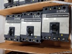Qty 3 - Square D molded case breakers.