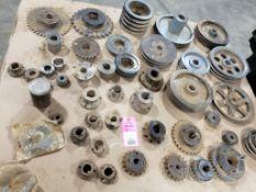 Pallet of assorted gears, pulleys, bushings.