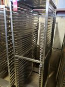 "Qty 2 - baking pan rolling rack. 21""Wx68""Hx26""D, 20""Wx72""Hx27""D."