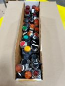 Assorted electrical indicator lights, pushbuttons.