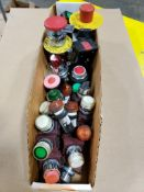 Assorted electrical indicator lights, pushbuttons, emergency stops.