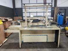 Industrial work table with forward shelves and overhead light. 98x36x90. LxWxH.