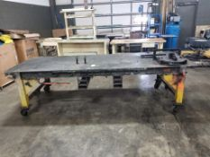 Industrial welding work table with steel tabletop and clamp fixture. 126x48x43. LxWxH.