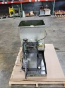 Pneumatic parts feeder station with hopper.