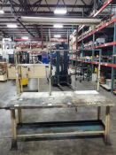 Industrial work table with forward shelf and light fixture. 76x30x90. LxWxH. Wood top under plastic.