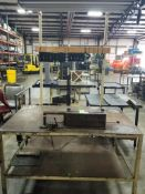 Industrial work bench with forward tool holding and overhead light. 66x39x90 overall LxWxH.