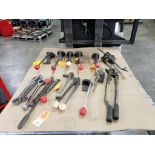 Assorted banding tools for parts or repair.