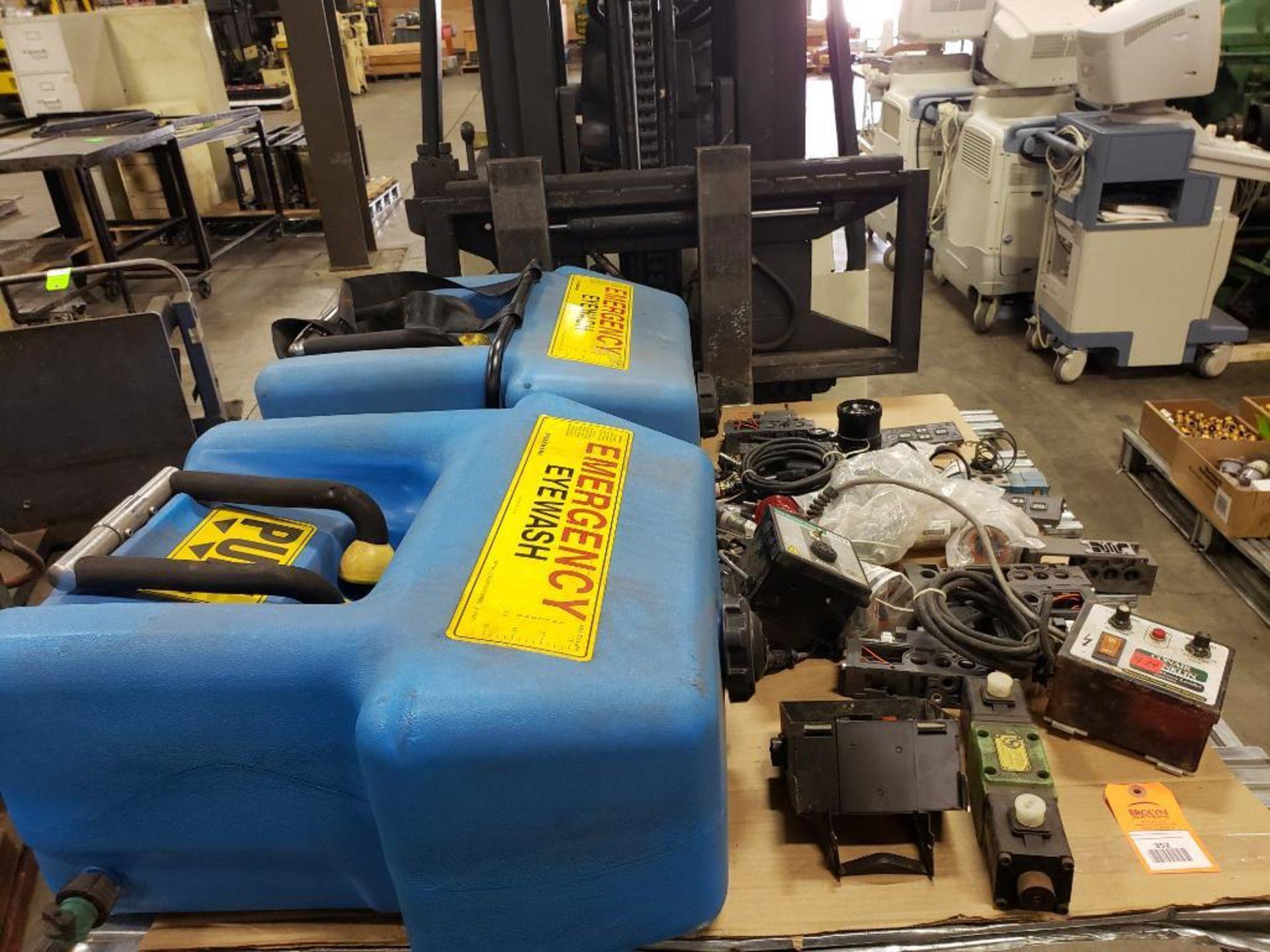 Pallet of assorted parts. Emergency eyewash, Conair universal terminal box, Hydraulik Ring valve.
