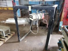 Coffing 1/2-Ton chain hoist with metal rack.