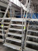 """Wheeled scaffolding ladder. 18FT Long x 36"""" Wide x 54"""" Tall (to deck), 94"""" (overall)."""