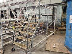 """Wheeled scaffolding ladder. 12FT Long x 36"""" Wide x 70"""" Tall (to deck), 90"""" (overall)."""