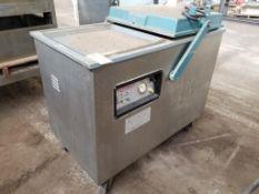 Webomatic vacuum machine.