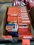 Large assortment of spark plugs. New in box.