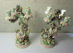 Pair of Continental Porcelain Candleabra, circa 19th century, Modelled as Figures with Sconces