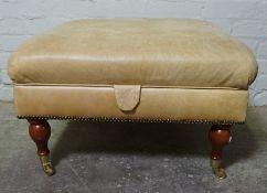 Modern Hide Footstool, Having a Hinged top, Terminating on Brass castors, 39cm x 70cm