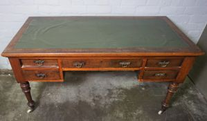 Stained Wood Kneehole Desk, circa late 19th / early 20th century, Having Fitted Drawers, Raised on