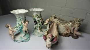 Pair of Continental Porcelain Cornucopia Vases, Modelled as Putti, 22cm high, Also with a 19th