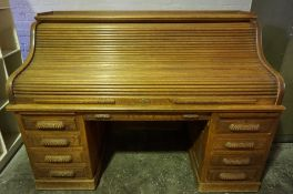Oak Roll Top Desk, Having a Tambour Roller Shutter enclosing fitted Drawers and Pigeon Holes, Raised