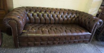 Chesterfield Three Seater Sofa by Wilson, Torn, 72cm high, 211cm wide