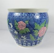 Chinese style Pottery Jardiniere, Decorated with Floral panels on a blue ground, 35cm high, 41cm