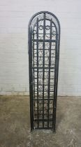 Gothic style Wine Rack, Having a door enclosing 36 open Bottle inserts, 131cm high, 30cm wide,