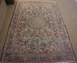 Persian Hand Knotted Rug, Decorated with allover Floral panels on a red, white and blue ground,