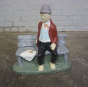 Painted Composite Stone Garden Figure, Modelled as a Man Sitting on a Bench, 17cm high