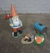 Four Painted Garden Ornaments, Modelled as a Knome, Mask, Gypsy Carriage and a Male, (4)