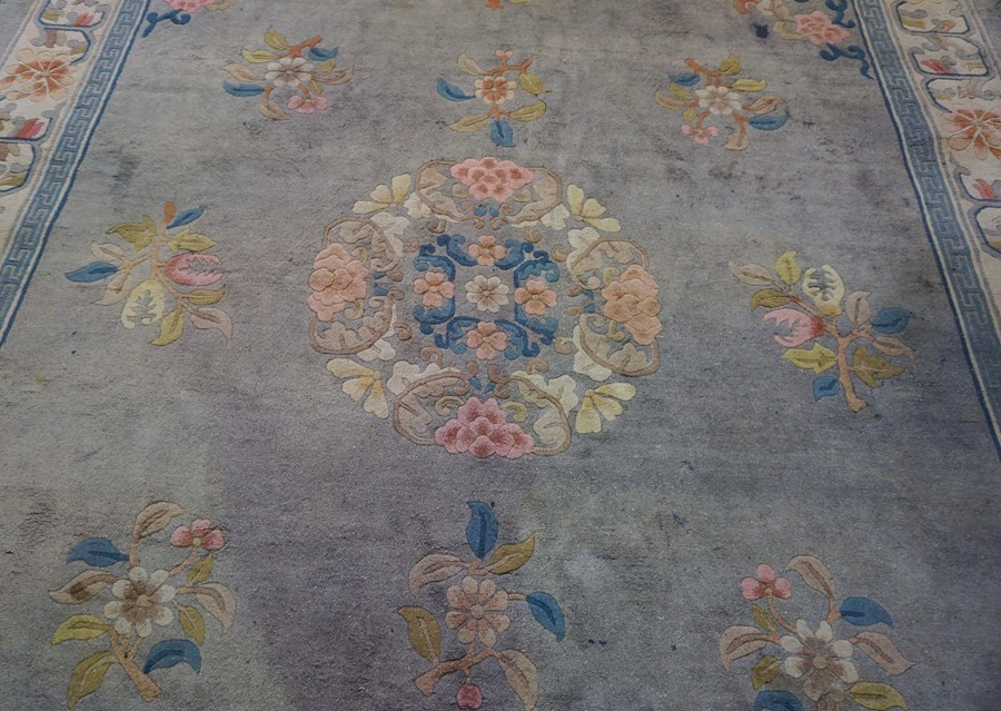Chinese Carpet, Decorated with Floral panels on a blue ground, 385cm x 273cm - Image 3 of 3