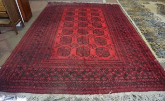 Turkish Carpet, Decorated with seven rows of three Geometric medallions on a red ground, 322cm x