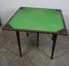 Mahogany Card Table, The fold over top enclosing a later green felt interior, The table extends on