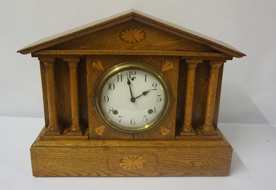 American Oak Inlaid Mantel Clock, circa late 19th century, In the Corinthian manner, Having a twin
