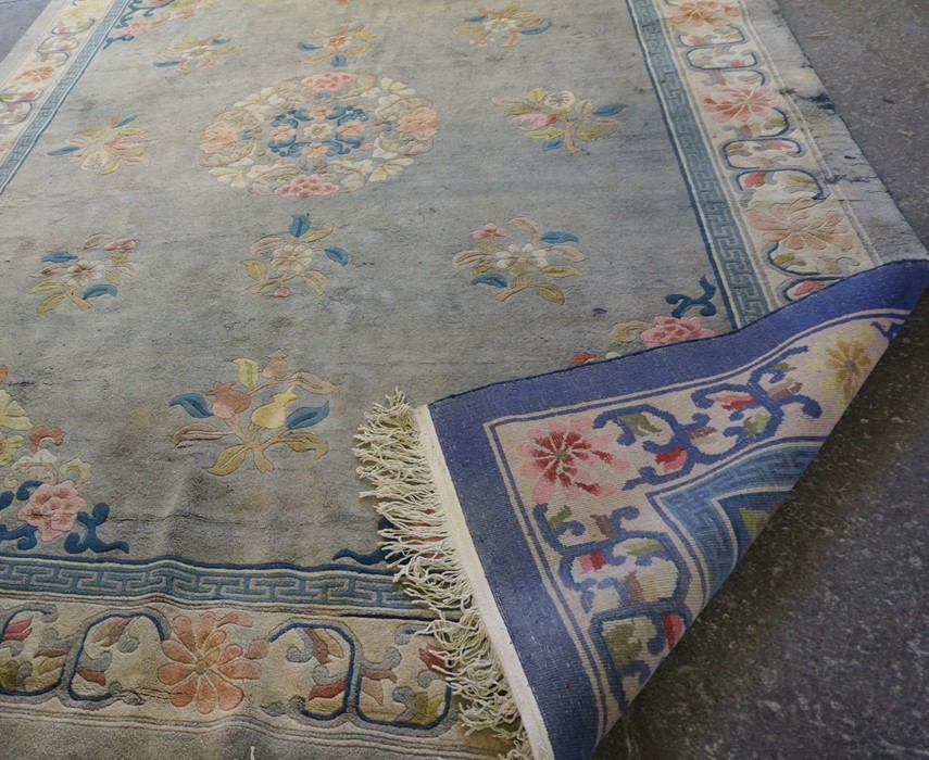 Chinese Carpet, Decorated with Floral panels on a blue ground, 385cm x 273cm - Image 2 of 3