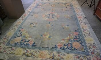 Chinese Carpet, Decorated with Floral panels on a blue ground, 385cm x 273cm