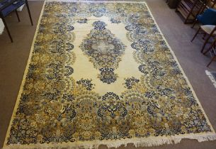 Super Keshan Machine Made Carpet, Decorated with Floral panels on a cream ground, 390cm x 300cm