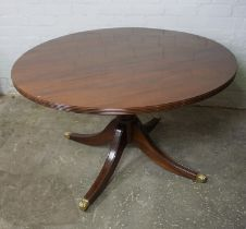 Modern Mahogany Pedestal Table, Having a circular top, Raised on quadrapartite supports with brass