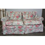 Fabric Two Seater Sofa, Having a Floral cover, 87cm high, 180cm wide