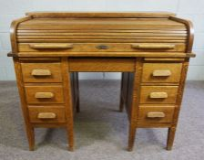 Oak Roll Top Desk,Circa Early 20th Century,Having a tambour roller shutter,Above a drawer,