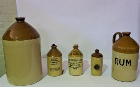 A Stoneware Bottle, Inscribed for Fentimens and bears date 1929, and four further bottles