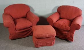 Two Orange Fabric covered arm chairs and a footstool